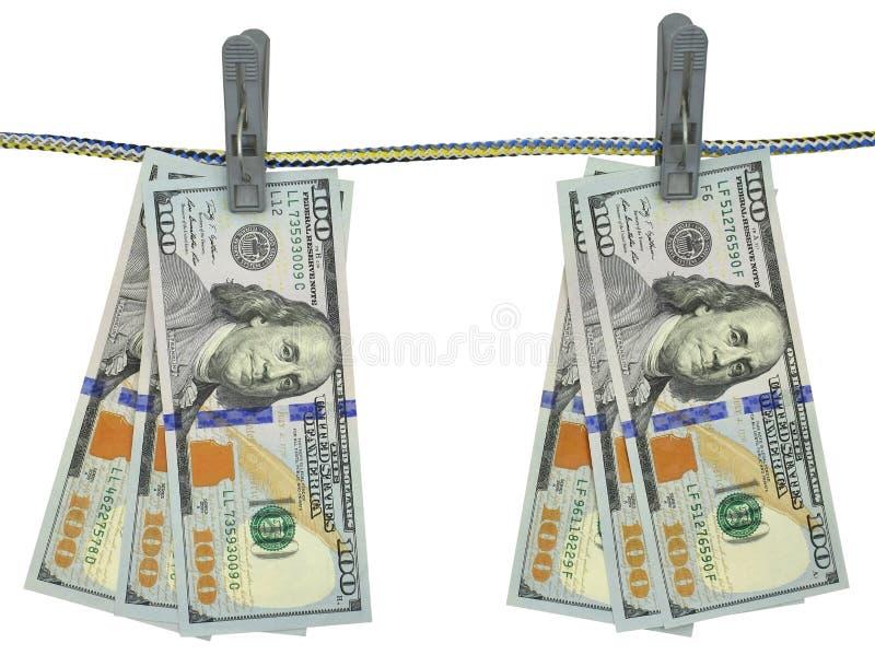 ` S del dollaro americano che appende sulla corda con le mollette da bucato fotografia stock