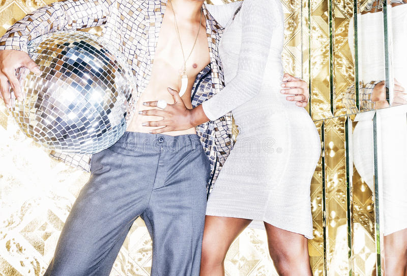Download 70s Disco Style Couple Posing With Mirror Ball Stock Photo - Image: 42391200