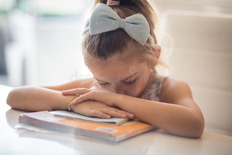 That`s enough. Little girl learning. Close up stock photography