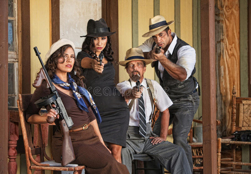 1920s Era Gangsters Aiming Guns. Group of four 1920s vintage gangsters aiming their guns stock photography