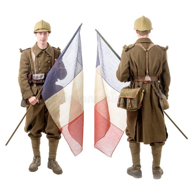 40s francuski żołnierz z flaga, plecy i frontowym widokiem odizolowywającymi dalej, obrazy royalty free
