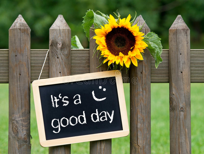 It`s a good day - chalkboard with text and sunflower stock photography