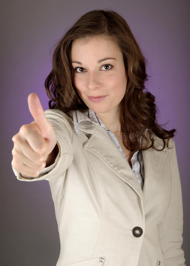 It`s great!. Brunette businesswoman with gray background stock photos