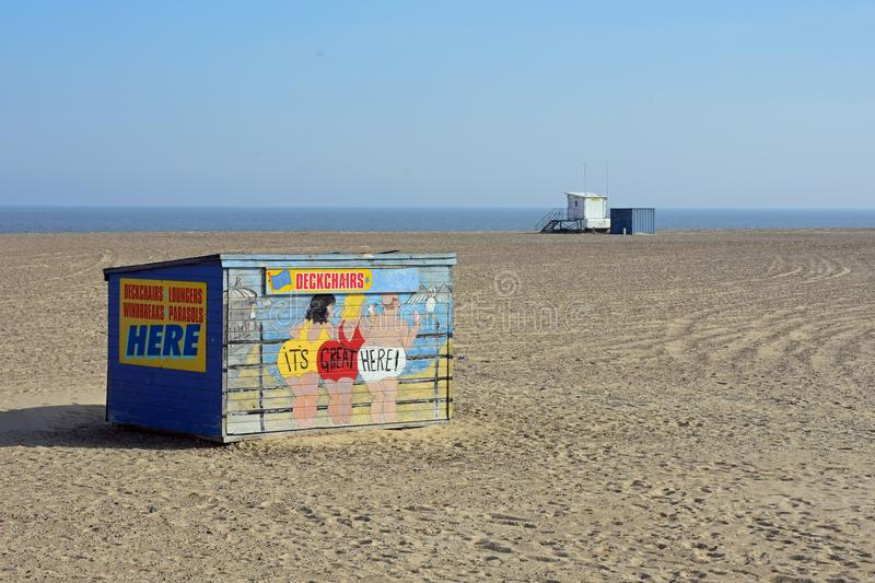 Quirky Deckchair Stall, Great Yarmouth, Norfolk, UK. It`s Great Here - Quirky Vintage Deckchair Stall on Great Yarmouth beach, Norfolk, England royalty free stock image