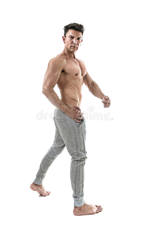 40s hispanic sport man and bodybuilder posing with naked torso showing fit muscular body stock images