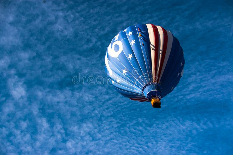Hot Air Balloon Takes Flight. It`s Labor Day Lift Off in Colorado Springs, CO. This patriotic balloon takes to the morning sky royalty free stock images