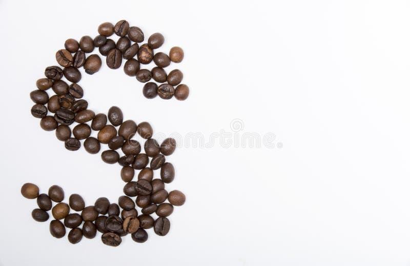 S - large letter of english alphabet. Made up of unmolished roasted coffee beans on a white background stock image