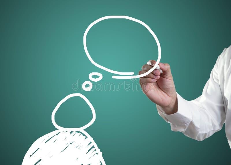 S?mbolo do ser humano com bolha do discurso no quadro-negro fotografia de stock