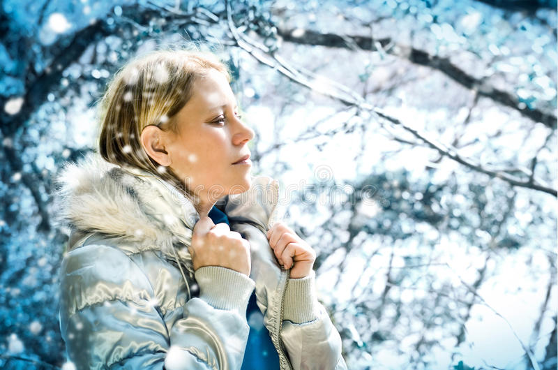 S-meli winter 1. Beautiful girl taking a walk in a winter forest royalty free stock photography