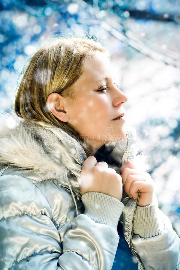 S-meli winter 2. Beautiful girl taking a walk in a winter forest royalty free stock photography