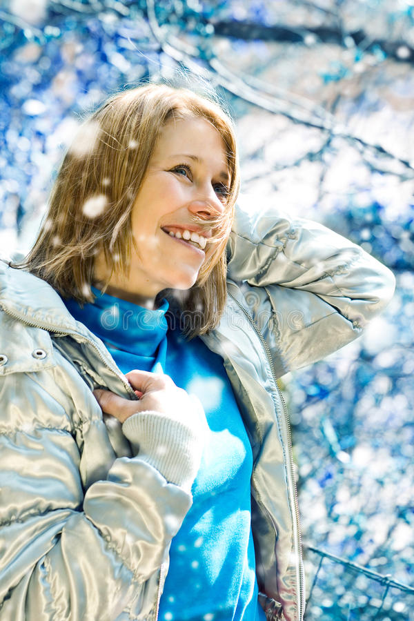 S-meli winter 3. Beautiful girl taking a walk in a winter forest royalty free stock photography