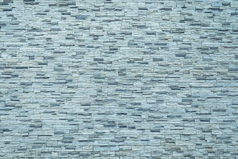 S?ml?s textur, bakgrund, sten fodrade med granitv?ggar sandsten stenbakgrundsv?gg Bel?gen mitt emot sten royaltyfria bilder