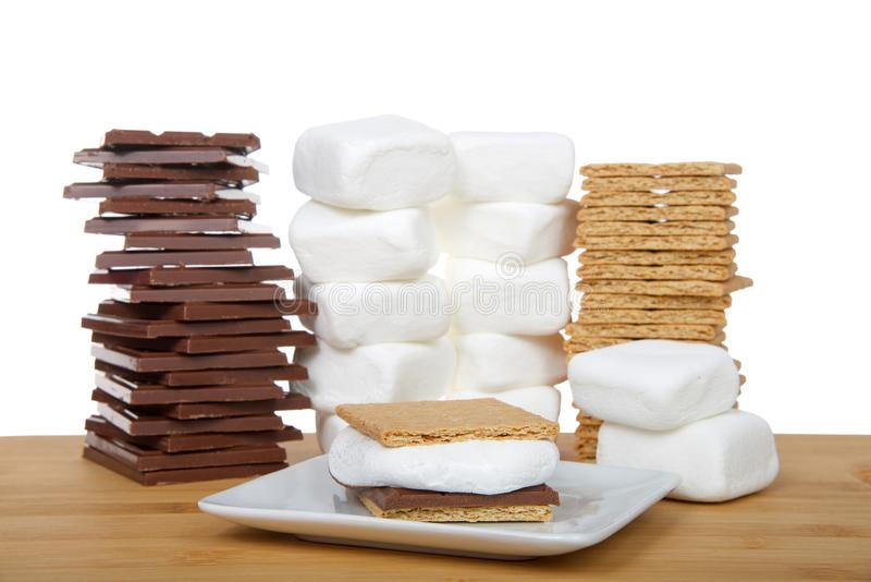 S`more on plate with supplies stacked in background isolated stock photos