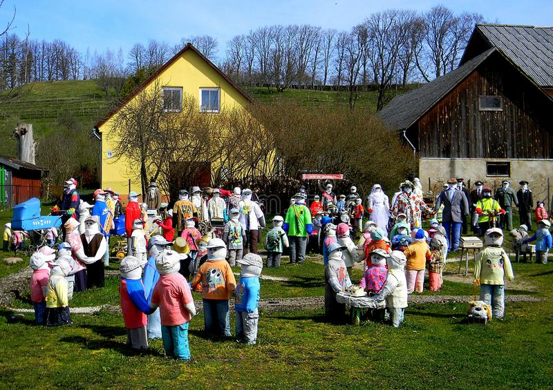 It`s my live neighborhood. Near the Winehill in a little square there stand many dolls made from straw. At this Garden you can see more than 200 dolls, dressed stock photos