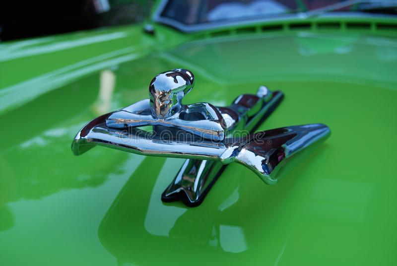 1950s Nash Hood Ornament George Petty Flying Goddess Wing. On refurbished car in bright green royalty free stock images