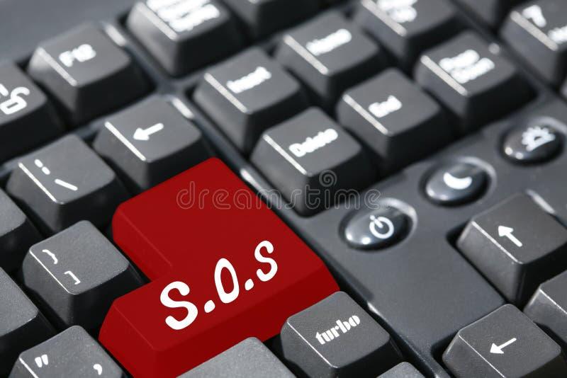 S.o.s écrit sur le clavier photographie stock