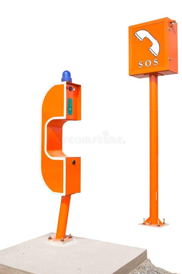 S.O.S.teken en telefoondoos op weg, verkeersveiligheid stock afbeelding
