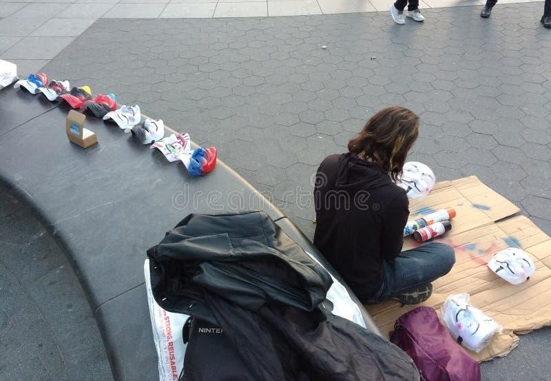 Street Artist, Guy Fawkes Masks, Washington Square Park, NYC, NY, USA stock image
