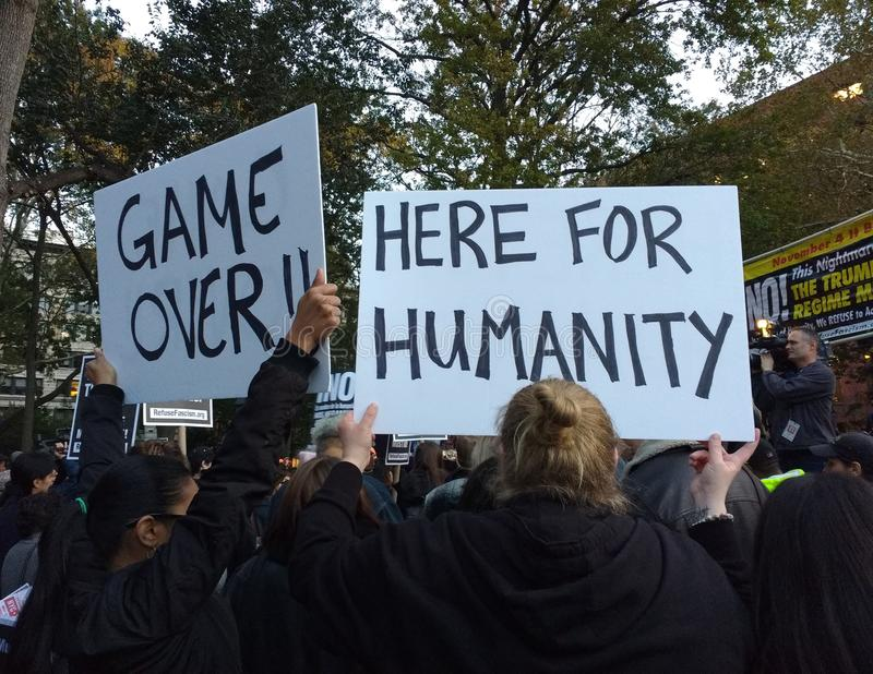 Game Over, Here For Humanity, Anti-Trump Rally, Washington Square Park, NYC, NY, USA. It`s almost one year after the historic election of Donald Trump as the royalty free stock images