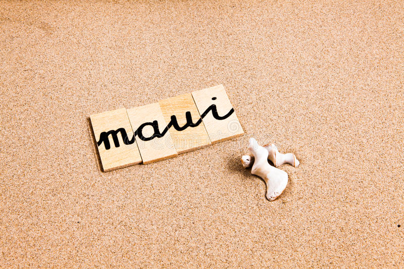 Download Słowa na piasku Maui obraz stock. Obraz złożonej z maui - 53784935