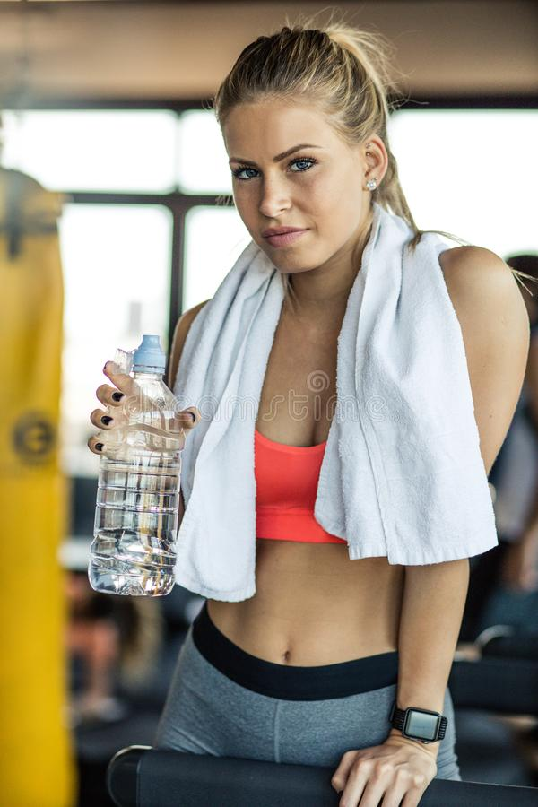 That`s refreshing. Woman at gym royalty free stock photo
