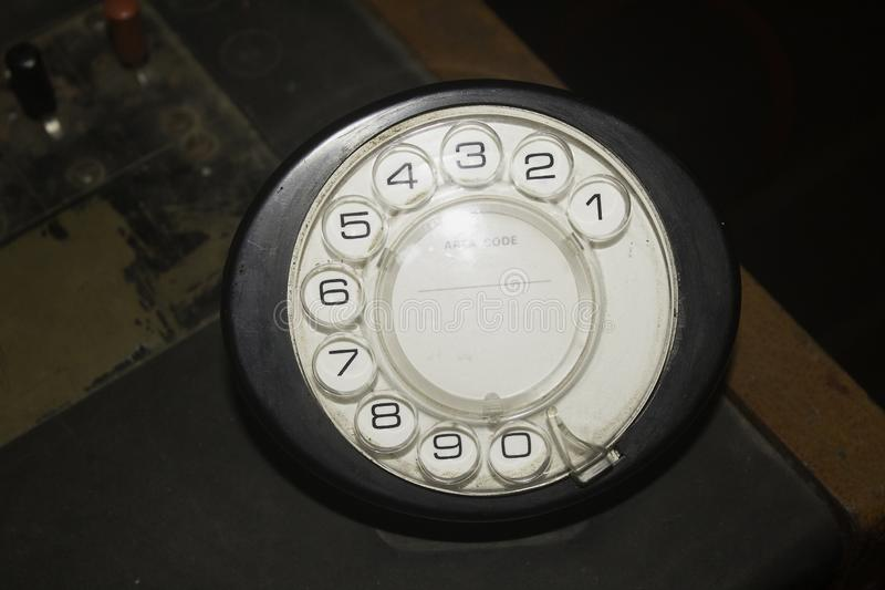 A 1970-80s retro style rotary dial telephone mechanism. With the numbers 0-9 stock images