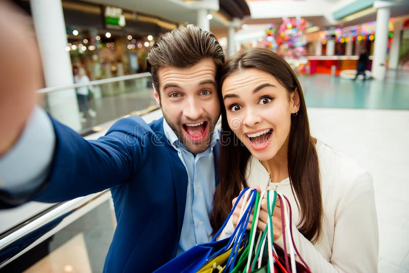 It`s shopping time with crazy sales and fun. Selfie portrait of stock photography