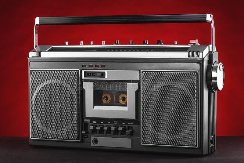 1980s Silver retro radio boom box on red background.  stock photo