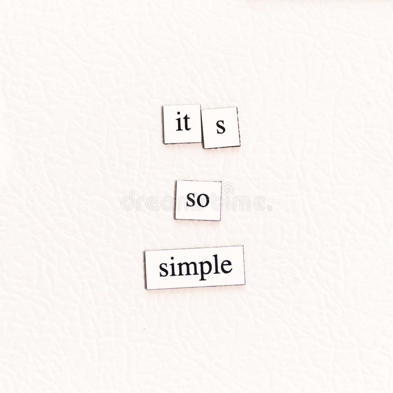 It`s So Simple. Magnets on a refrigerator stating `it`s so simple stock photography