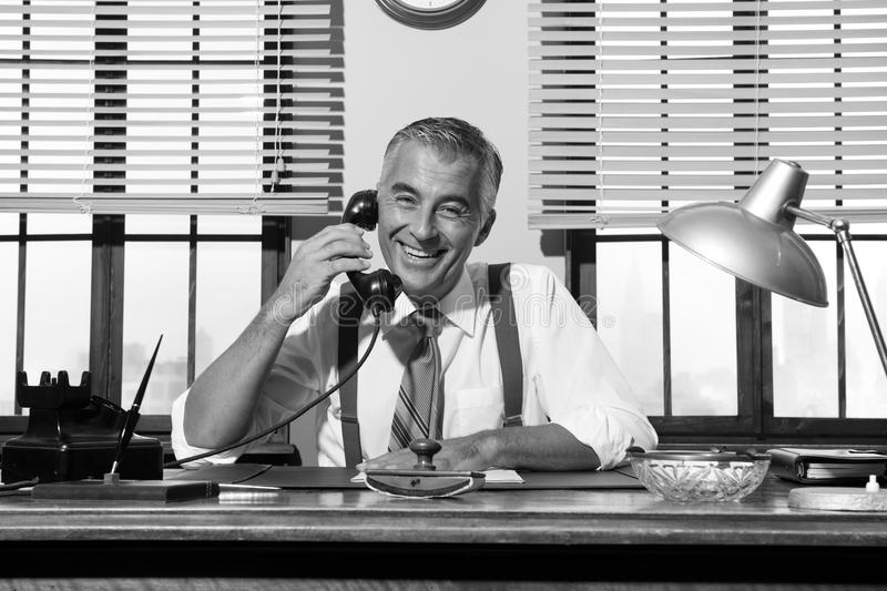 1950s smiling businessman on the phone royalty free stock photos