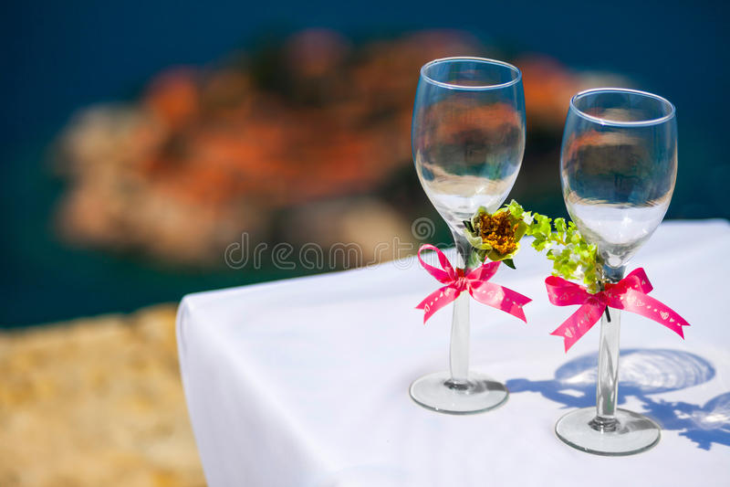 S.Stefan. Wedding wineglasses on background of S.Stefan island.Montenegro royalty free stock photos