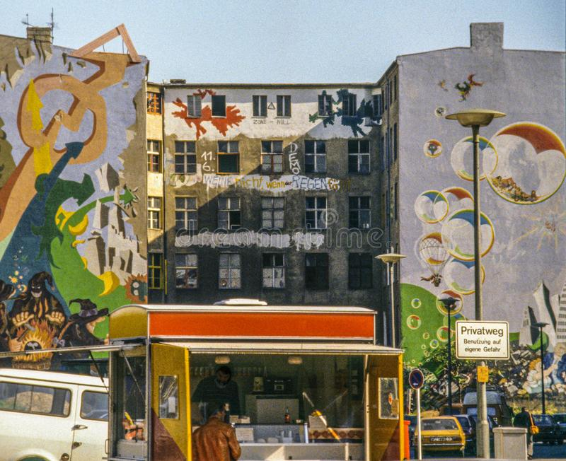1980s style graffiti in then West Berlin with food wagon royalty free stock photo