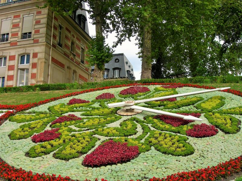 It´s ten past four in a beautiful flower´s clock. Buildings, trees, nature and a big amazing flowers and plants clock. It´s ten past four in a beautiful royalty free stock photo