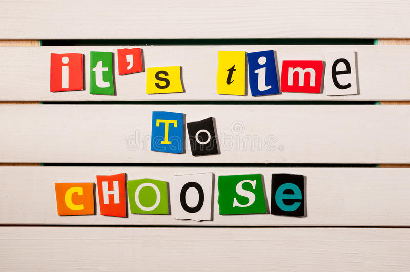 It's time to choose - written with color magazine letter clippings on wooden board. Concept image.  royalty free stock images