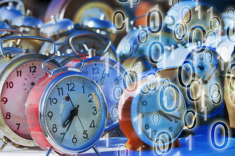It`s time to protect your data - Concept image with old colored metal table clocks with binary code stock images