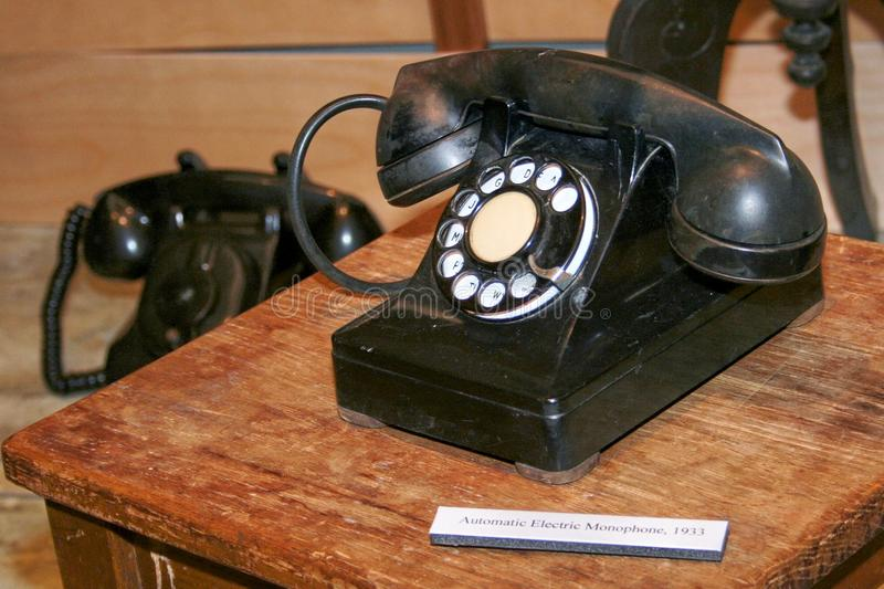 1930s to 1950`s black telephone with rotary dial. royalty free stock photography