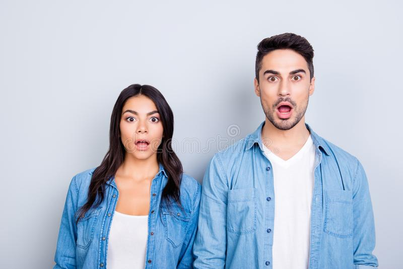 It`s unbelievable! Portrait of two shocked and surprised people royalty free stock photo