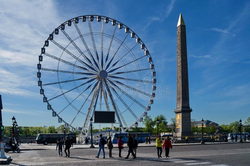 A monument and ferris wheel in the plaza DE Paris, France. It`s very interesting that the two buildings are built together,One is serious and the other is active royalty free stock photos