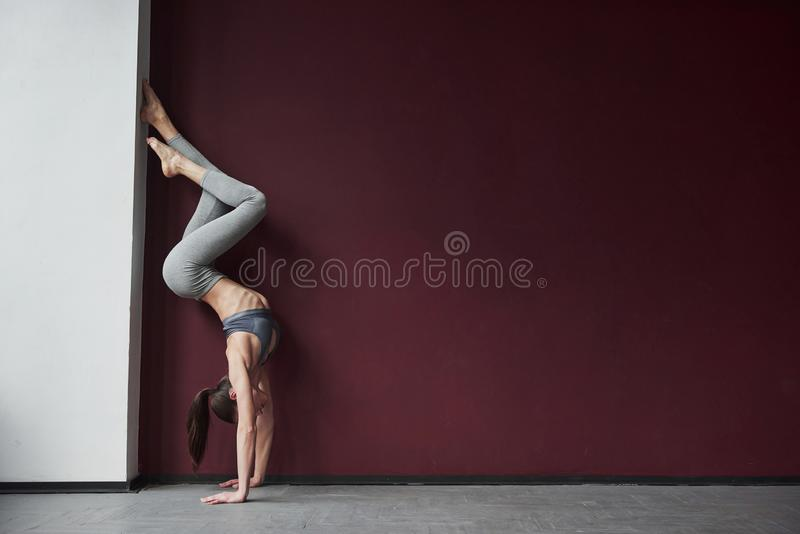 That`s what health human and energy looks like. Girl with good fitness body type have exercises in the spacey room.  stock photo