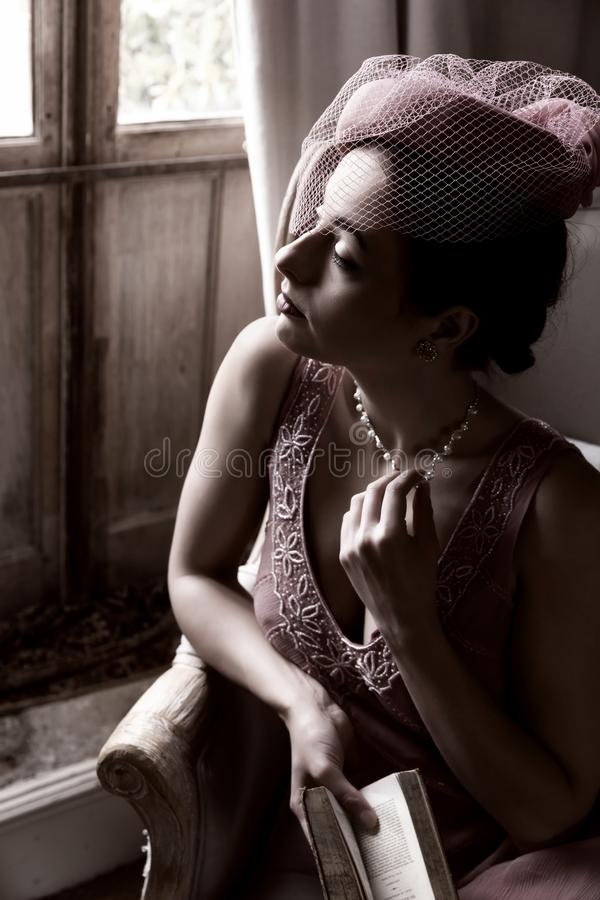 1920s woman in dark room royalty free stock photos