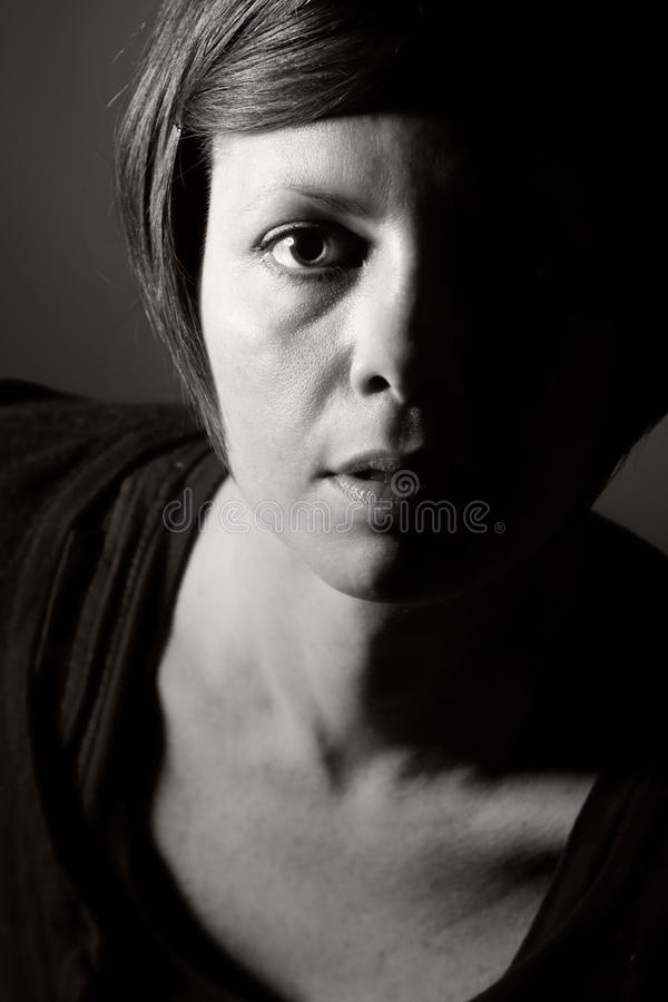 30s Woman. Low Key Photo of 30s Woman royalty free stock photos