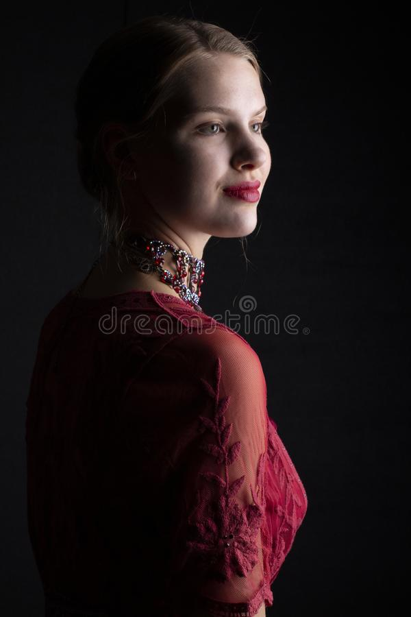 1910`s woman in red lace dress. Early 20th century woman wearing a red lace dress with a satin chemise and a crystal necklace stock photos