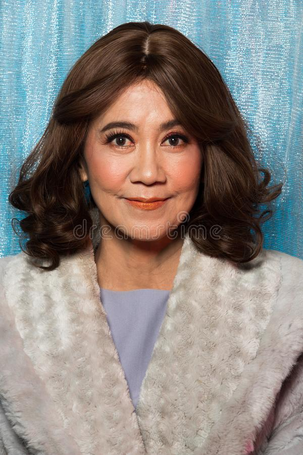 50s 60s years old Fashion Asian Woman Portrait. 50s 60s years old Fashion Asian Woman with Update style and make up Hairstyle want show Face, Eyes Summer Spring stock photo
