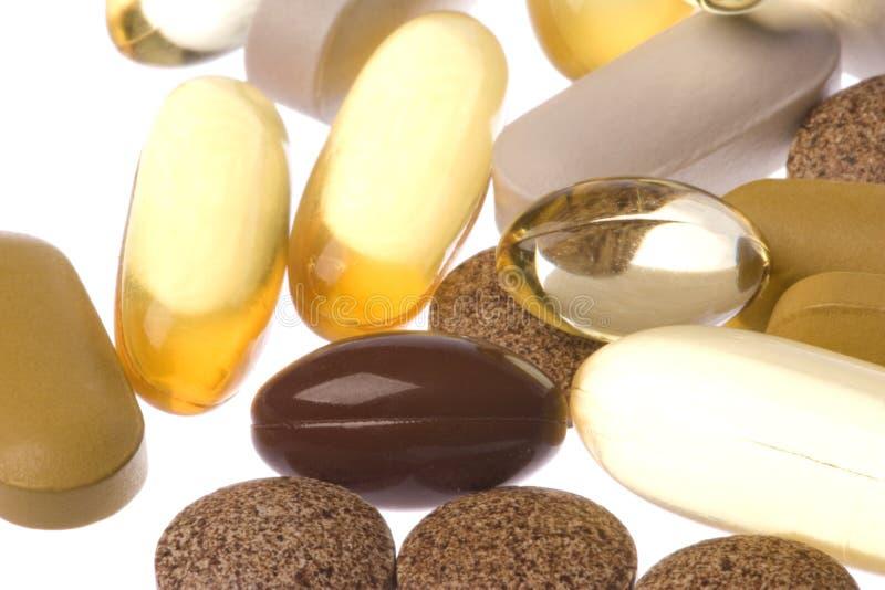 A saúde suplementa o macro isolado foto de stock