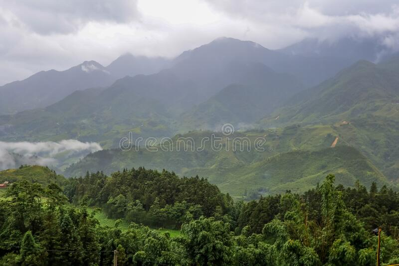 Morning fog,cloudy sky and mountain ranges in Sapa,Lao Cai Province,north-west Vietnam. Sa Pa or Sapa,is a frontier township and capital of Sa Pa District in Lao royalty free stock photography