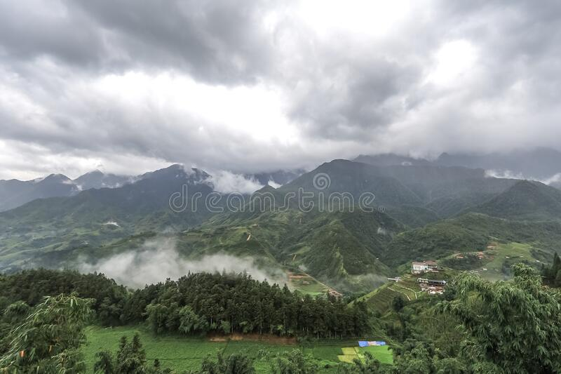 Morning fog,cloudy sky and mountain ranges in Sapa,Lao Cai Province,north-west Vietnam. Sa Pa or Sapa,is a frontier township and capital of Sa Pa District in Lao royalty free stock image