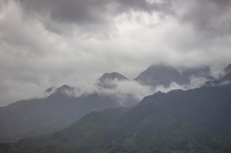 Morning fog,cloudy sky and mountain ranges in Sapa,Lao Cai Province,north-west Vietnam. Sa Pa or Sapa,is a frontier township and capital of Sa Pa District in Lao stock photos