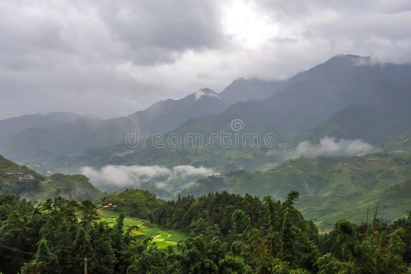 Morning fog,cloudy sky and mountain ranges in Sapa,Lao Cai Province,north-west Vietnam. Sa Pa or Sapa,is a frontier township and capital of Sa Pa District in Lao royalty free stock images