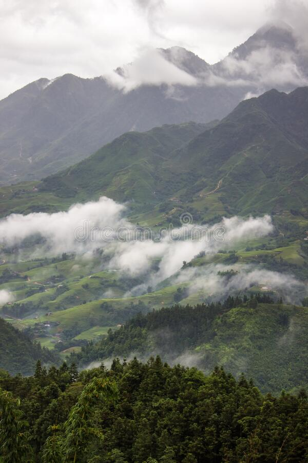 Morning fog,cloudy sky and mountain ranges in Sapa,Lao Cai Province,north-west Vietnam. Sa Pa or Sapa,is a frontier township and capital of Sa Pa District in Lao stock photography