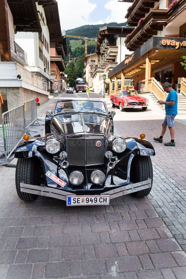 Vintage car Clenet oldsmobile veteran roadster. SAALBACH-HINTERGLEMM, AUSTRIA - JUNE 21 2018: Vintage car Clenet oldsmobile veteran roadster produced in 1970s royalty free stock photography